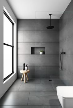 bathroom tiles Would you dare to go dark We love a dramatic space and this bathroom was created with our Evolution Matt Natural Grey tiles. Made from hard wearing porcelain they feature an authentic brushed stone effect finish . Black Tile Bathrooms, Bathroom Tile Designs, Bathroom Floor Tiles, Wall And Floor Tiles, Modern Bathroom Design, Bathroom Interior Design, Small Bathroom, Grey Floor Tiles Bathroom, Shower Tiles