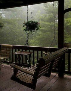 Imagine waking up in a cozy cabin in the mountains and walking out into this porch with hot tea in hand, inhaling the fresh smell of an early morning rain :) Peaceful. ~ yes, i want a porch like this and a swing. I always love sitting on the porch. Outdoor Spaces, Outdoor Living, Outdoor Kitchens, Cozy Room, Cozy Cabin, Cozy House, Cabins In The Woods, Cottage In The Woods, House In The Woods