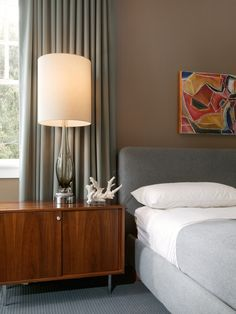Midcentury table lamps lend themselves well to any space featuring low-slung furniture, and they're easy to find at vintage stores. Look for curvy bases in bold hues, paired with tall, slim lampshades, like this Murano glass lamp designer Kenneth Brown used atop a vintage Knoll nightstand