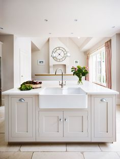 Harvey Jones Shaker kitchen with white cabinets and large island