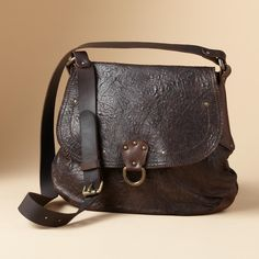 """ARTEMIS BAG--Classic styling in textured Italian lambskin with a smooth leather strap, adjustable for shoulder or crossbody wear. Magnetic snap flap with antiqued brass rivets and ring. Pigskin lined with zip and open pockets. Made in USA. 11""""W x 3-1/2""""D x 14""""H."""