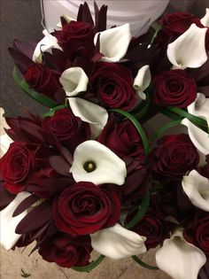 White calla lilies and rich red roses bouquets. Bridesmaid Bouquet, Wedding Bouquets, Wedding Flowers, Wedding Flower Packages, Groomsmen Boutonniere, Red Rose Bouquet, Flower Packaging, Calla Lilies, Flower Making
