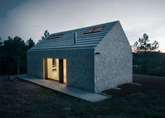 Rural Slovenian cottage has walls of stone set into concrete