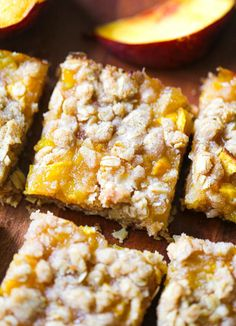 Peach Lovers! You'll truly want to dive into these tasty, home-made Oatmeal Peach Crumble Bars! This delicious and easy to make bar dessert is made with an chewy oatmeal crust and crumble topping and a scrumptious peach filling. Such a perfect snack or dessert when peaches are ripe and ready to use! This peach bar recipe is a lot like a peach crisp, but easier and more fun to share with friends and family since it's in bar form! So awesome for picnics or potlucks!