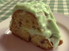 """This cake uses yellow cake mix, instant pistachio pudding and it's covered with a pistachio flavored whipped topping."""