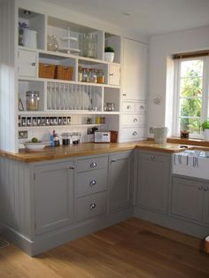 **I like the gray and am really starting to like the wood looking countertops** Farrow & Ball Colours Skimming Stone and Charleston Gray - I like this kitchen very much, but I would paint the cabinets country blue rather than gray.