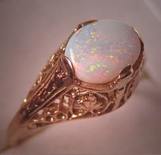 A Stunning Vintage Australian Opal Gold Filigree Ring, Art Deco Style Setting in 14K Yellow Gold from the Fine Estate Jewelry Collection.