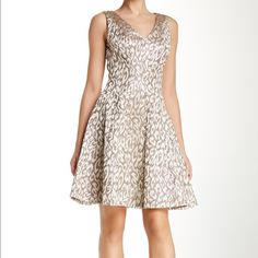 The perfect fit and flare holiday dress. This beautiful dress by Vince Camuto is the perfect dress for the holidays. Shimmer and shine gold material takes this dress to a whole new level. Double lined. Material is 56% cotton 34% polyester and 10% metallic. Vince Camuto Dresses Midi