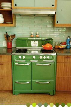 Vintage stove with metallic green subway tile back splash.