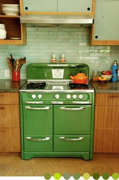 Vintage stove with metallic green subway tile back splash.