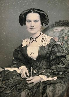 Lady c. 1850's with a very unique hairstyle, poses for her portrait.