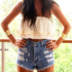 high waisted shorts and crop top, gold arm cuffs