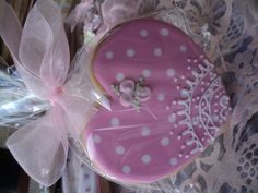 Cookie decorated with royal icing and lace