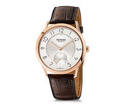 Slim d'Hermes Hermes rose gold watch, 39.5mm diameter, opaline silvered dial, Hermes Manufacture H1950 ultra-thin movement, matte alligator leather strap Color: Havana brown