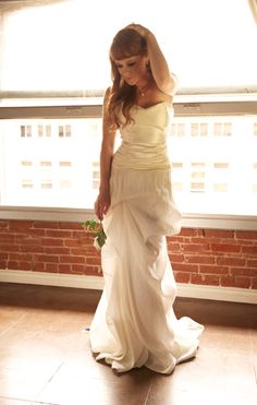 Hempsilk satin bodice over a hempsilk satin skirt with graceful pickups and rusched waist. An elegant and sophisticated eco couture gown.