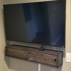 Rustic wood floating shelf with hidden compartment & magnetic lock, rustic home decor, rustic shelves, wood shelf,farmhouse floating shelf Floating Media Console, Rustic Wood Floating Shelves, Wood Shelves, Storage Shelves, Pipe Shelves, Storage Ideas, Hidden Shelf, Hidden Storage, Hidden Compartments