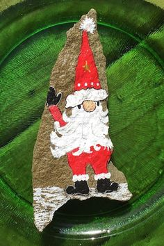You'll receive the same one of it's kind Santa gnome painted rock gift seen in the pictures and video. This is a natural rock made of slate that's painted on the front. The back is left in it's natural state and signed by yours truly. Painted Rocks For Sale, Hand Painted Rocks, Unique Christmas Gifts, Christmas Ornaments, Holiday Decor, Gnome Paint, Custom Paint, Gnomes, Picture Video