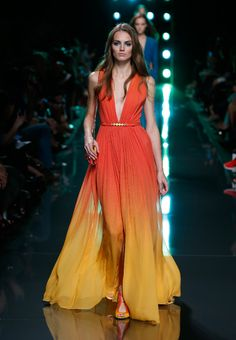 Elie Saab Spring/ Summer 2015- Tropical reef colors and dipped hemlines. Like a soothing beach sunset.