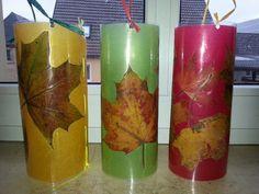 Laternen  Herbstblätter auf buntem Transparentpapier -> laminiert und mit Bast zusamnenhenäht