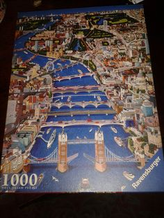 London, a view to the west jigsaw with miniature reproduction of puzzle picture and artist's biography