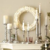 silver candlestick mantle... Wonder if you can buy cheap candle sticks, and use Metallic Spray paint to make them look silver?
