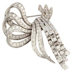Large 1950's Articulated Diamond Bow Brooch | From a unique collection of vintage brooches at https://www.1stdibs.com/jewelry/brooches/brooches/