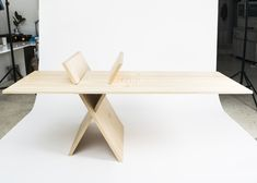 The 'X' Table, by Mayice Studio, is made from only three pieces of pine, and assembled without fasteners. The centre area is apparently to hold office related items like pencils and pens.