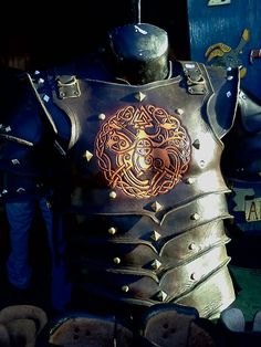 I tooled this breastplate. Studded leather armor by Digger.