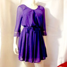❤❤Flash saleElegant violet dress Gorgeous... Features a scoop neck and crochet sleeves Speechless Dresses