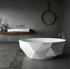 GEOMETRIC Go geometric with Kelly Hoppen's shapely Bijoux bath. The strikingly chiseled form draws inspiration from faceted diamonds and is the product of the second collaboration between Kelly Hoppen and Apaiser.