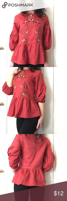 """NWT Rust Colored Blouse NWT Hidden Alley Rust Colored Blouse with Embroidery Detail *Size: SMALL *55% cotton, 45% linen  Approx. Measurements  Length: 24.5"""" Chest: 17.5"""" across Arm length: from underarm-11"""", from seam at collar-19.5""""   Tags: Nwt new blouse rust embroidery top shirt small linen sale bundle deals discount clothes Hidden Alley Tops Blouses"""