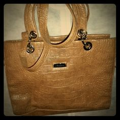 **Final Price** Gold/Tan Handbag This handbag can be carried as a shoulder or just with the handles. In great condition no signs of wear. Has two zippers on the side as well. **PRICE IS FIRM** Alfred Dunner Bags Shoulder Bags
