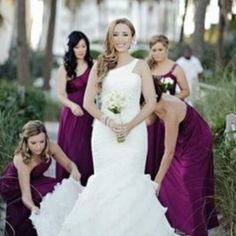 I like that the bride is the focus, the maids are helping and their in the photo.