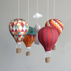 FREE WORLDWIDE SHIPPING! Colour: Carnival This is a Do-It-Yourself craft kit. The Hot Air Balloon mobile kit comes with all the materials you need to make your baby mobile. Choose from a variety of colours and patterns: https://www.etsy.com/uk/shop/ButtonFaceCo You will make and stuff