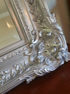 Bring new life to an old mirror frame with Rub'n Buff.  Tutorial (a very funny one!) by BIG FAMILY / small apartment.