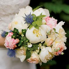   SouthernLiving.com  Peony, Hydrangea, and Garden Rose Bouquet    This bouquet mixes lush elements—peonies, eryngium, garden roses, lacecap hydrangeas, hypericum berries, and blueberries—with pops of color and texture from the blooms of the spiky eryngium.