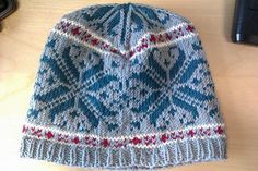 This pattern was inspired by a holiday in Norway where there were so many lovely knitted bits for sale. Unfortunately I could not bring them all home with me, so I have made my own souvenir.