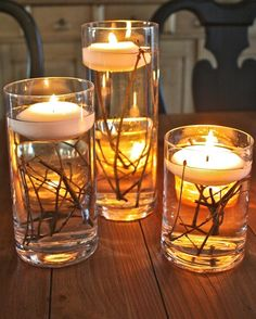Simple twigs in a glass vase or container of your choosing, add water and a floating candle. I love the simplicity of these.  Candles are relaxing and set a really nice mood in a room.  I also love them because they remove any smoke and/or odors out of the room.  Love them.