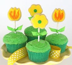 Spring cupcakes with flower cookie toppers
