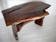 """""""this table was built from local reclaimed black walnut. the wood was milled by me and dried for 4 years. there is a ton of figure in this walnut. i hand carved the top to receive tenon plugs and a black walnut """"butterfly"""", this locks in a crack that runs in from the end grain. this table as been polished silky smooth. i finished it by hand rubbing multiple coats of pure linseed, sweet orange oil and beeswax. """""""