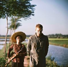 American airman Dewey Wayne Waddell, held prisoner in Vietnam, 1967 - This picture was created for propaganda purpose, hence the use of a really small woman as the guard to make the captured airman look less heroic.