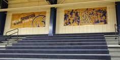 Gymnasiums can be a dime a dozen: wooden floors, brick walls, and plain bleachers. This describes most gymnasiums in the country. College Campus, Brick Walls, Wooden Flooring, Athletics, Lockers, Stairs, Graphics, Gym, Home Decor
