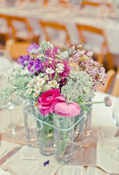 smaller vases tied together to make one centerpiece.