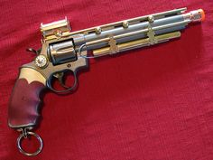 Another steampunk revolver - I like the brass accents.