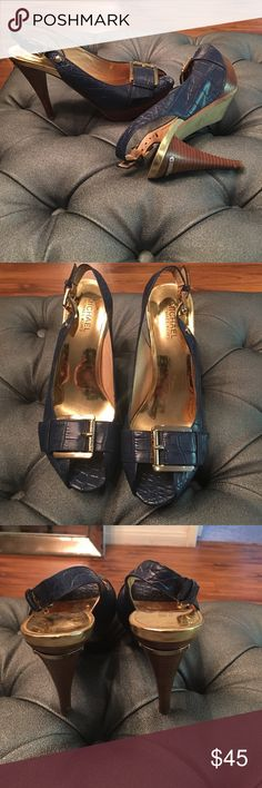 Michael Kors heels Deep blue and brown gold combo heels with label on back and on the sole. Gently used scuff on soles and some on shoe. Size 7 1/2. Very comfortable and super cute Michael Kors Shoes Heels