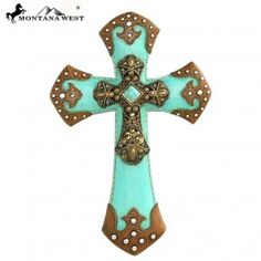 """Turquoise Resin Texture Wall Cross $24.95 + Shipping 11.5"""" Layered with bronze cross with a turquoise stone in the middle.  Decorated with rhinestones.  Measures approx : 7.48"""" X 1.1"""" X 11.5"""".   www.thecowboysway.com"""