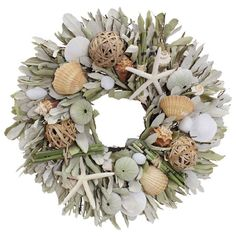 Artful on its own or anchoring a beach-chic vignette, this eye-catching wreath features integrifolia, rattan balls, starfish, and assorted shells. Place a pi... $41.95