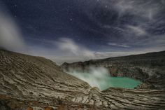 My favorite shot of the Mt. Ijen crater lake, East Java under a blanket of stars. Kind of feels like trekking through a desolate alien world.  The crater lake which resides at it's basin is recognized as the largest highly acidic crater lake in the world with a pH level of 0.5. I don't really know what that means but I reckon its safe to leave your swimsuit at home.