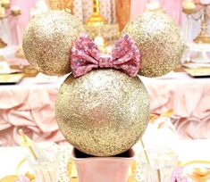 Loving the gorgeous centerpiece at this Minnie Mouse Birthday Party!! See more party ideas and share yours at CatchMyParty.com #minniemouse #centerpiece