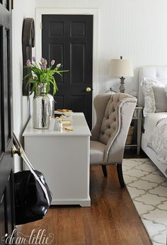 This oversized mercury glass vase from HomeGoods adds a nice little sparkle to this gray and white office/guest room.(sponsored pin)